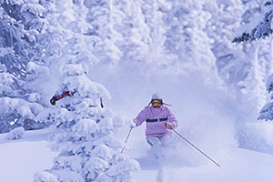 Vail Skier in Deep Powder