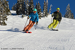 Steamboat Skiers on a Groomer