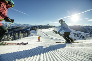 Vail Skiers on Groomed Run