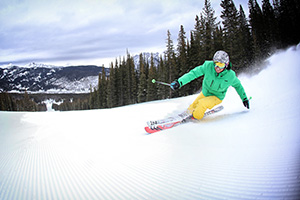 Skier on groomed run